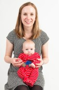 Studio photograph of young baby boy in bright clothes with his mother. Photographed by Anna Hindocha/Warm Glow Photo