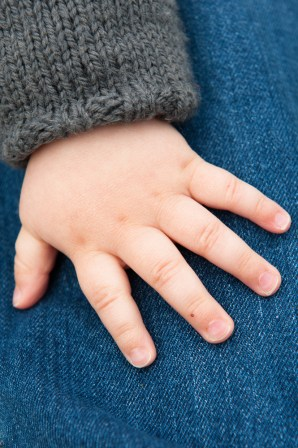 Close up of the hand of a one year old boy Photographed by Anna Hindocha/Warm Glow Photo