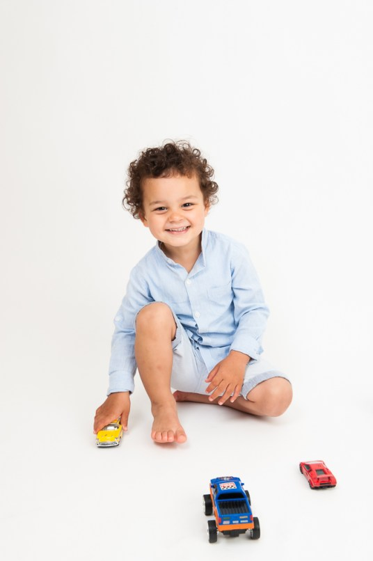 Studio portrait of young boy in blue shirt. Photographed by Anna Hindocha/Warm Glow Photo