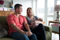 Newborn baby girl and parents photographed by Anna Hindocha/Warm Glow Photo