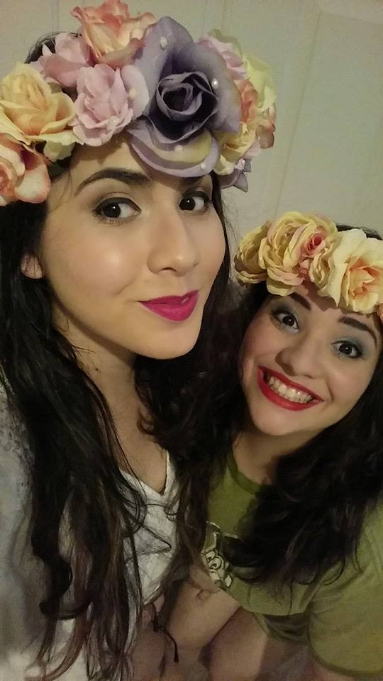 That's me wearing my very first PINK lipstick alongside my gorgeous big sister.  PS. I made those flower crowns because flower crowns are awesome.