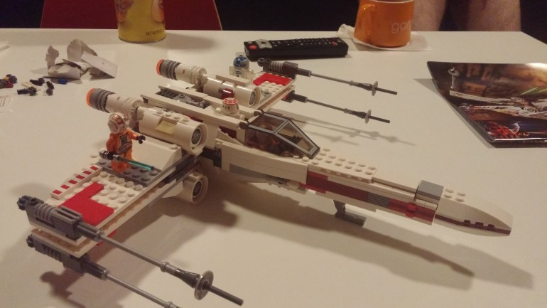 Damian and I finished building this X-Wing last night. I felt pretty awesomely accomplished. It'll be our centerpiece for our Thanksgiving feast.