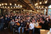 huge-group-of-people-saying-cheers-in-a-restaurant