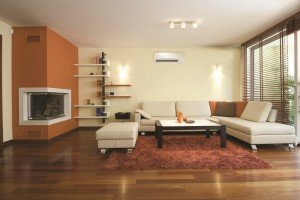 Living room with ductless air conditioning and heating system from Warren Hunting and Cooling.