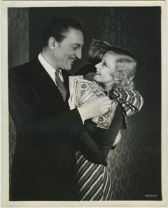 Warren William and Ginger Rogers