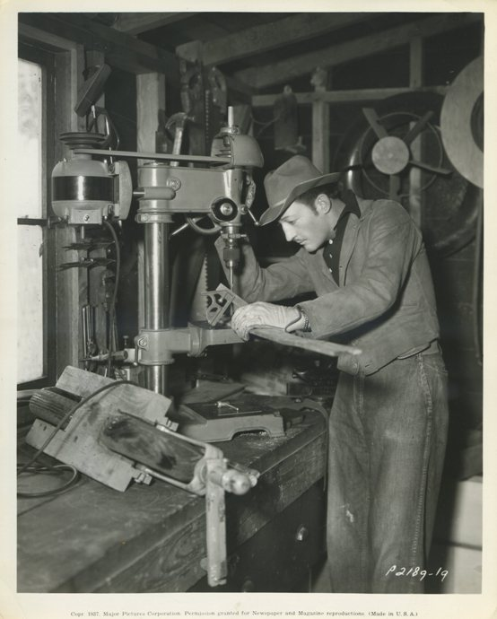 Warren William in his workshop