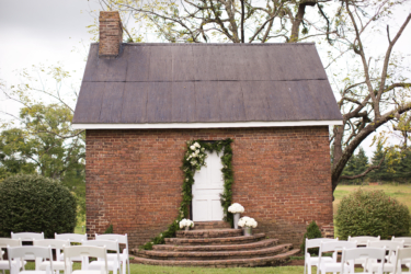 Kentucky summer estate wedding- Outdoor ceremony with all white flowers and greenery