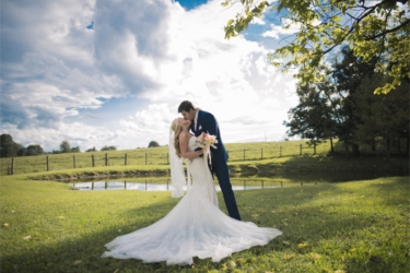 Bride & Groom in Green Pasture at Warrenwood Manor