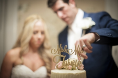 Couple cut cake with gold laser cut cake topper