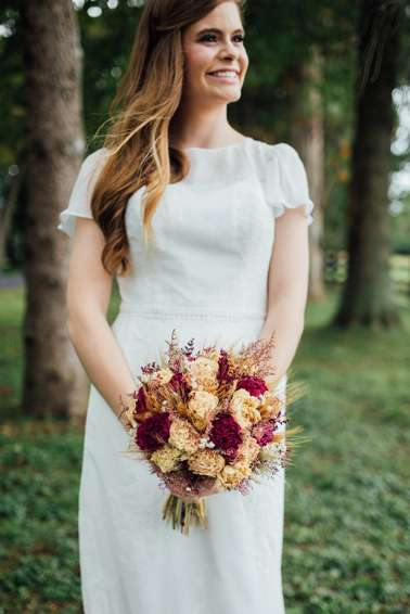 Fall Bride with timeless dress and perfect wavy hair