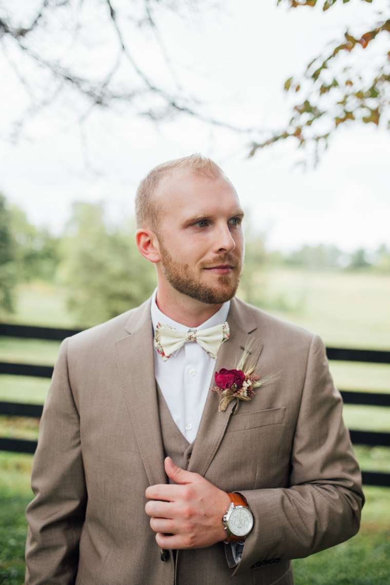 Groom dressed in light brown three piece suit