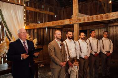Groom and Groomsmen await the Bride in barn wedding ceremony