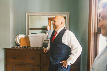 Groom getting ready in groom's quarters at Warrenwood