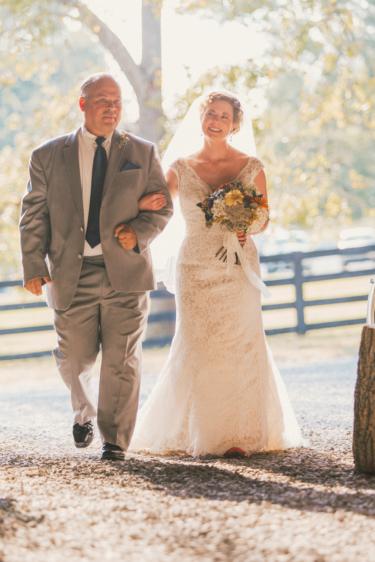 Bride and Father of Bride enter barn