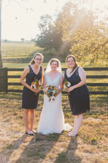 Bride with her bridesmaids at summer farm wedding, Navy dresses