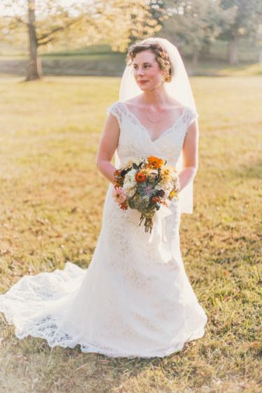 Bride in V-neck wedding dress with short train