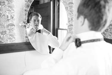 Groom getting ready for wedding at Warrenwood Manor, a central Kentucky wedding venue