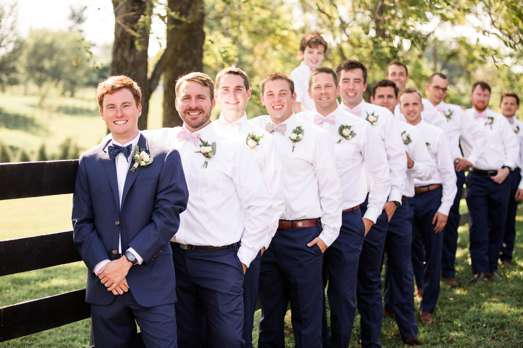 Classy southern groomsmen in navy and white for estate wedding
