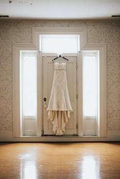 Wedding dress hanging in historic Warrenwood Manor