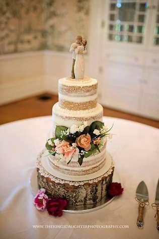 Ivory naked layered wedding cake on wood slice