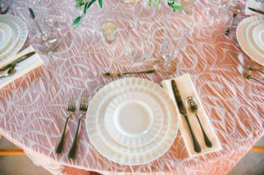 Pink and Ivory tablesetting with Ivory plates and silver utensils