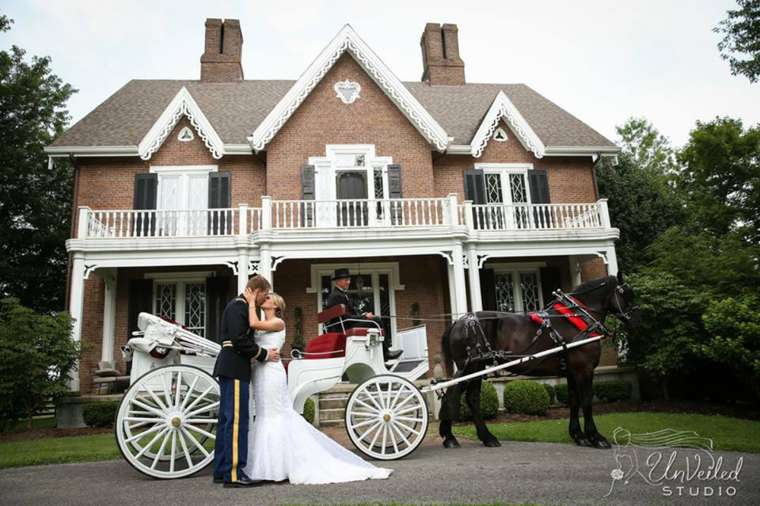 Bride and Groom with horse-drawn carriage in front of Warrenwood