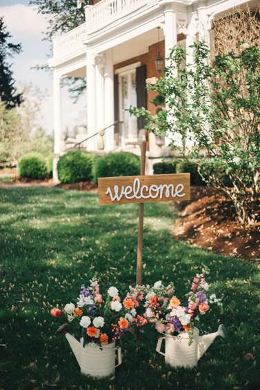 Wedding Welcome Sign with flower-filled watering cans