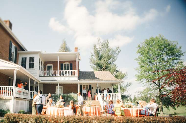 Outdoor wedding reception set up on the back porch and patio at Warrenwood Manor