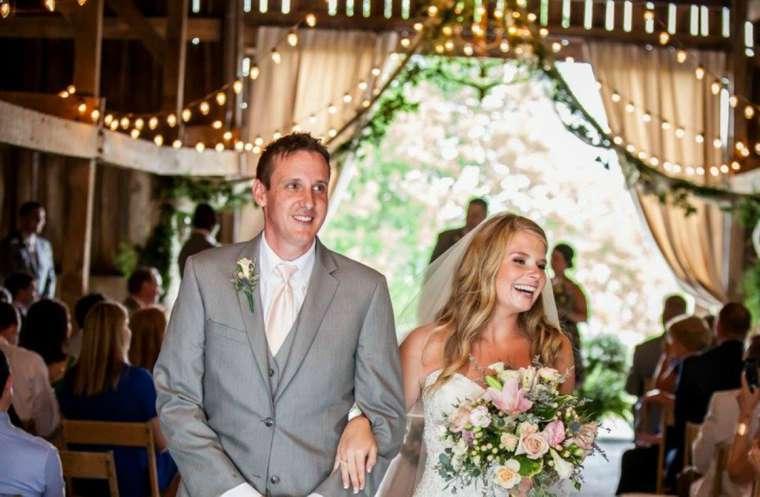 Bride & Groom exit barn wedding ceremony at Warrenwood