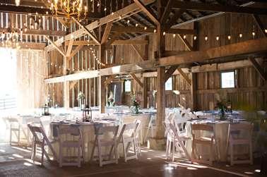 Barn wedding reception with chandeliers