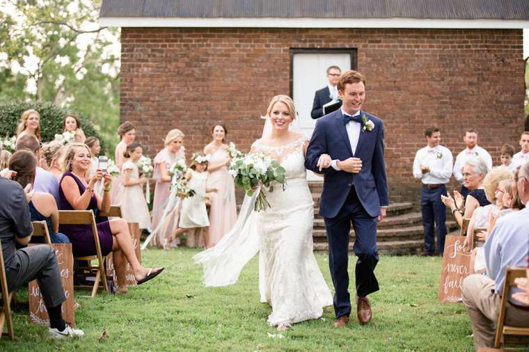 Bride and groom exit their outdoor dapper southern wedding