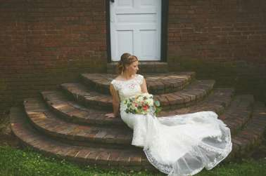Bride with pastel florals on cascading steps