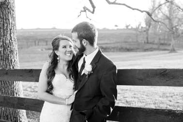 Black and white portrait of bride and groom during spring outdoor wedding