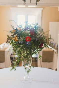 Large floral arrangement in entry hall of historic Warrenwood Manor