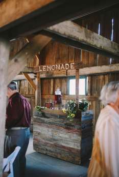 Cute lemonade stand for drink station at wedding reception