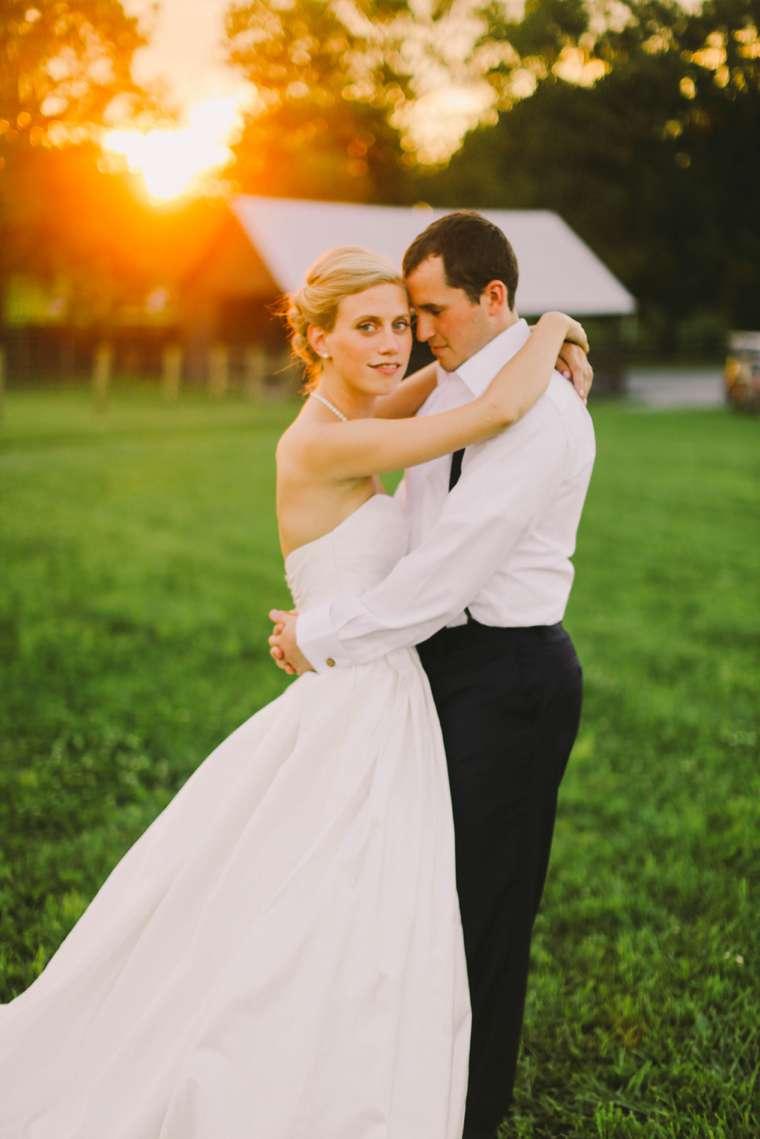 Sunset photos of couple during summer Kentucky farm wedding