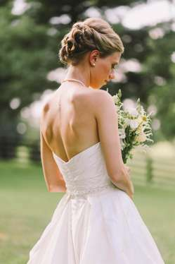 Bride at Warrenwood Manor with strapeless dress and updo