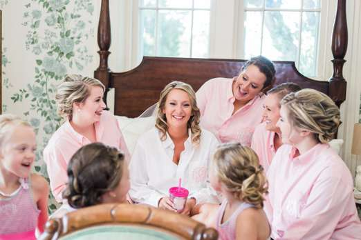 Bridal party getting ready in monogrammed button-downs
