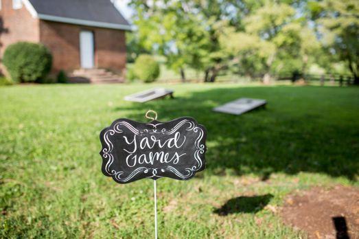Yard games at outdoor summer wedding reception