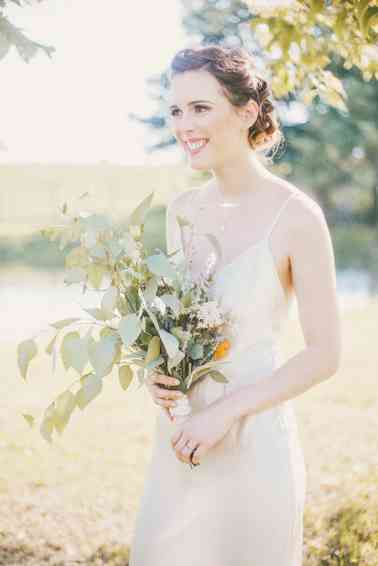 Organic greenery bridal bouquet with eucalyptus and herbs, photo by Cassie Lopez Photography