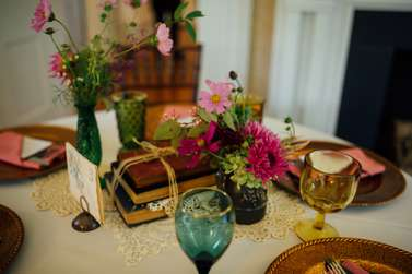 Vintage centerpieces with old books, bud vases and crochet doily. Hazelfield Farm. Erin Trimble Photography.