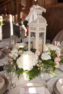 Vintage vibes centerpiece with white lantern and soft florals. Christy Lee Photography. Swan's Landing Flowers.