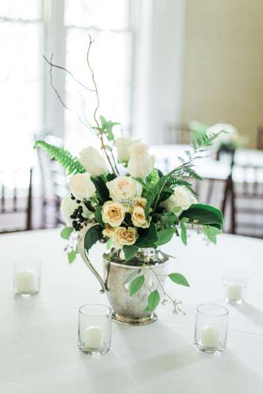 Traditional centerpiece, white, green & peach , in silver pitcher. Emily Wakin Photography