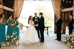 Traditional romantic wedding ceremony in Warrenwood barn