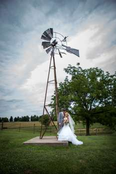 Bride & Groom with windmill at Warrenwood Manor