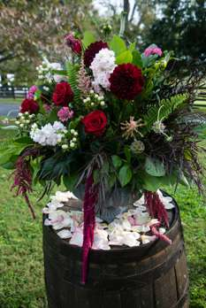 Mixed floral arrangement for alter of outdoor fall wedding ceremony