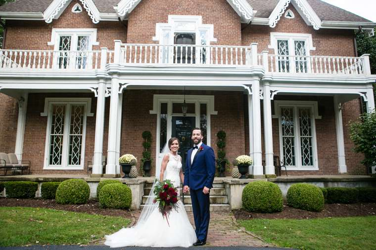 Bride & Groom in front of Warrenwood Manor, a stunning central Kentucky wedding venue