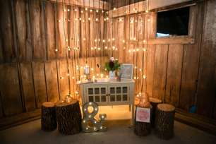 Guestbook table with twinkle light backdrop