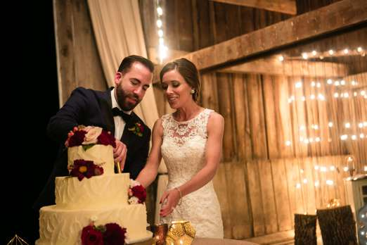 Cake cutting at classy rustic glam wedding reception