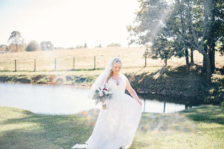 Candid photo of bride at fall outdoor wedding in Kentucky